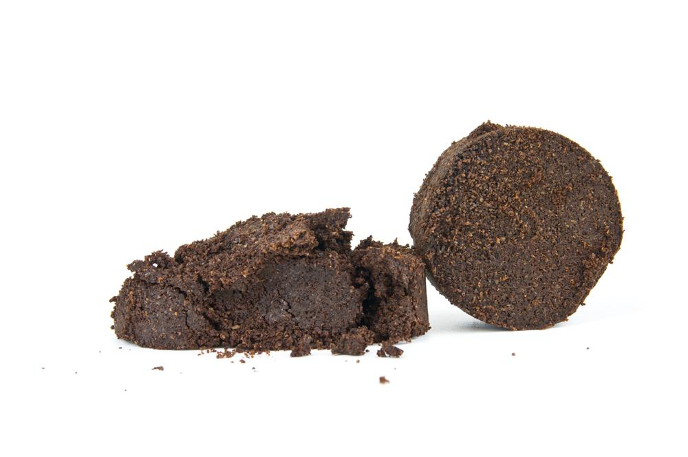 """A chemical engineer has created a """"food biorefinery"""" that converts used coffee grounds and other food waste into succinic acid (Photo: Shutterstock)"""