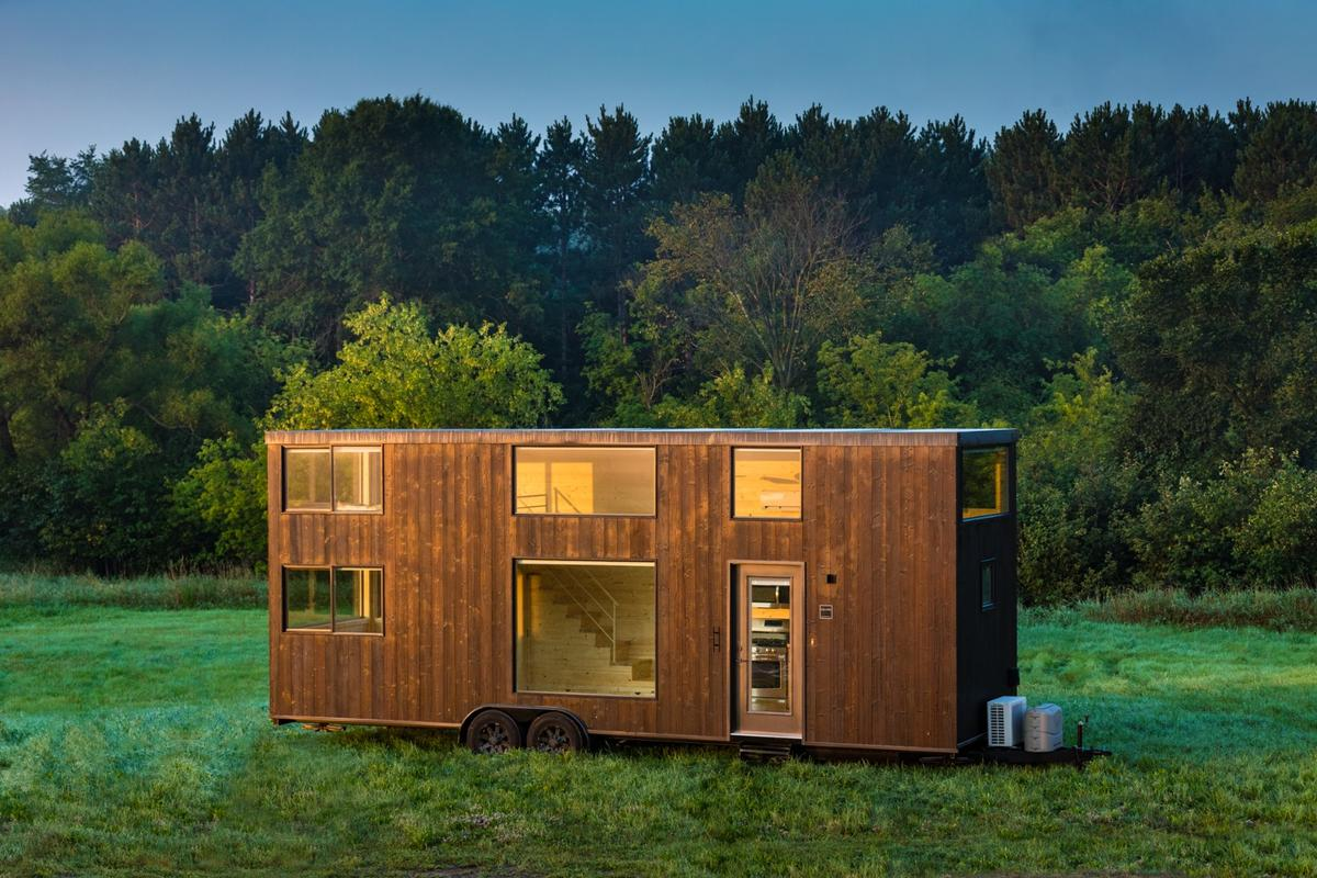 The One XL's exterior is clad in Shou Sugi Ban siding, which is a Japanese method of charring wood to preserve it