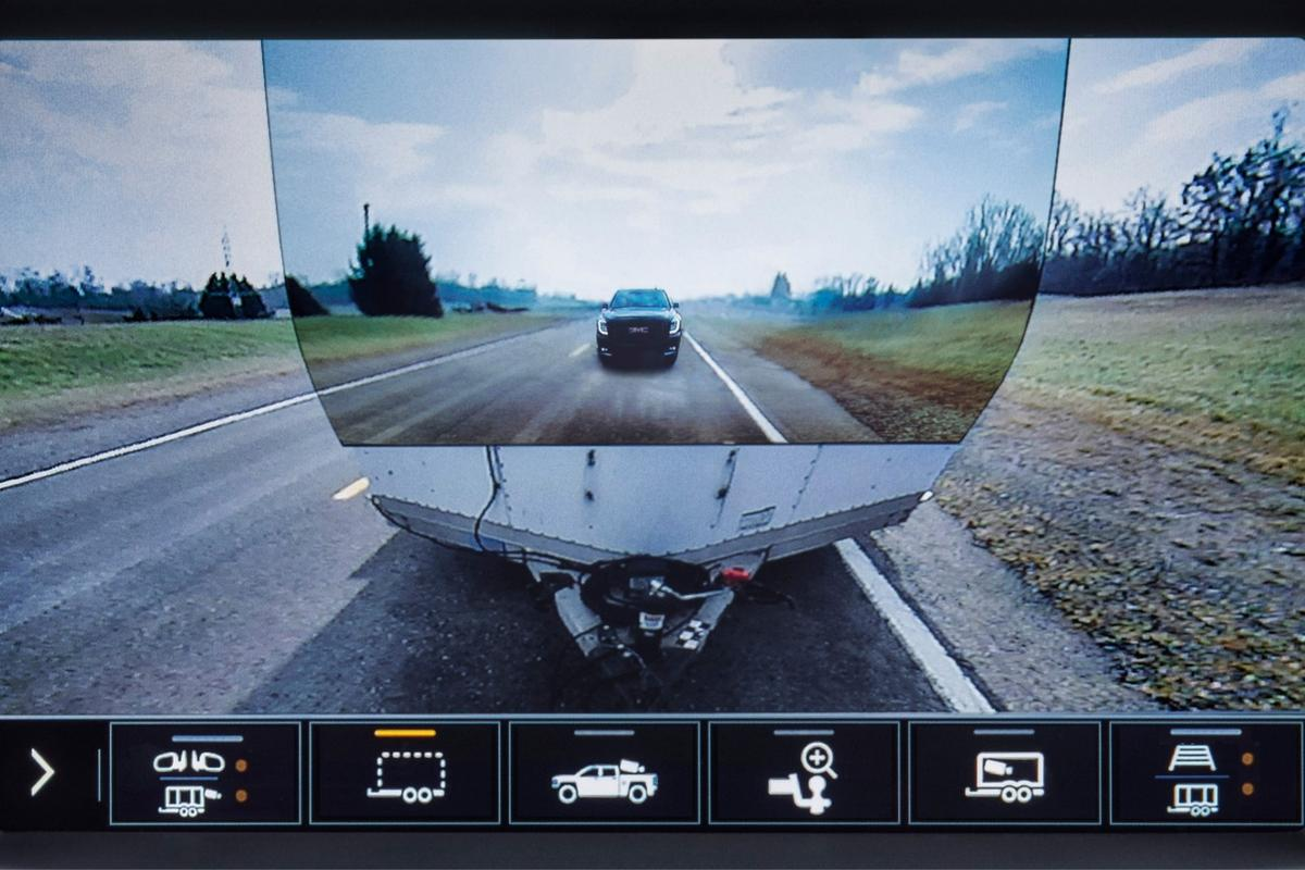 Transparent trailer view combines the outputs of the reversing camera and the trailer-mounted rear view camera to let you look through your trailer as if it's not there