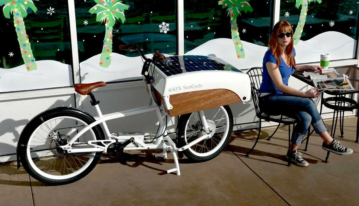 The NTS SunCycle charges its battery using a built-in solar panel