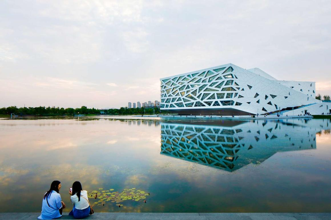 The Hangzhou Yuhang Opera is located next to a manmade lake