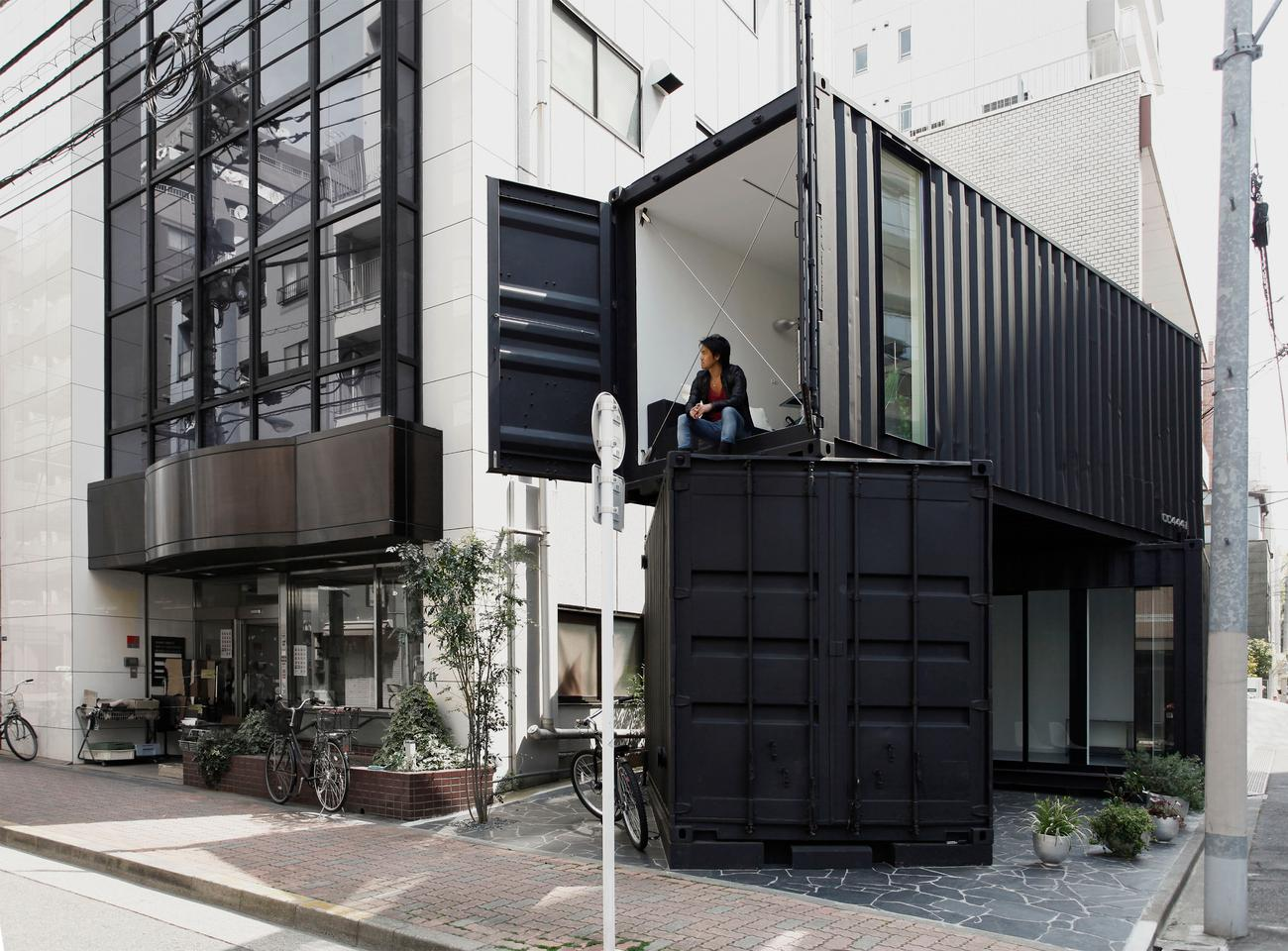 Double story container site disguises a modern office space designed by Japanese architectural firm, Tomokazu Hayakawa