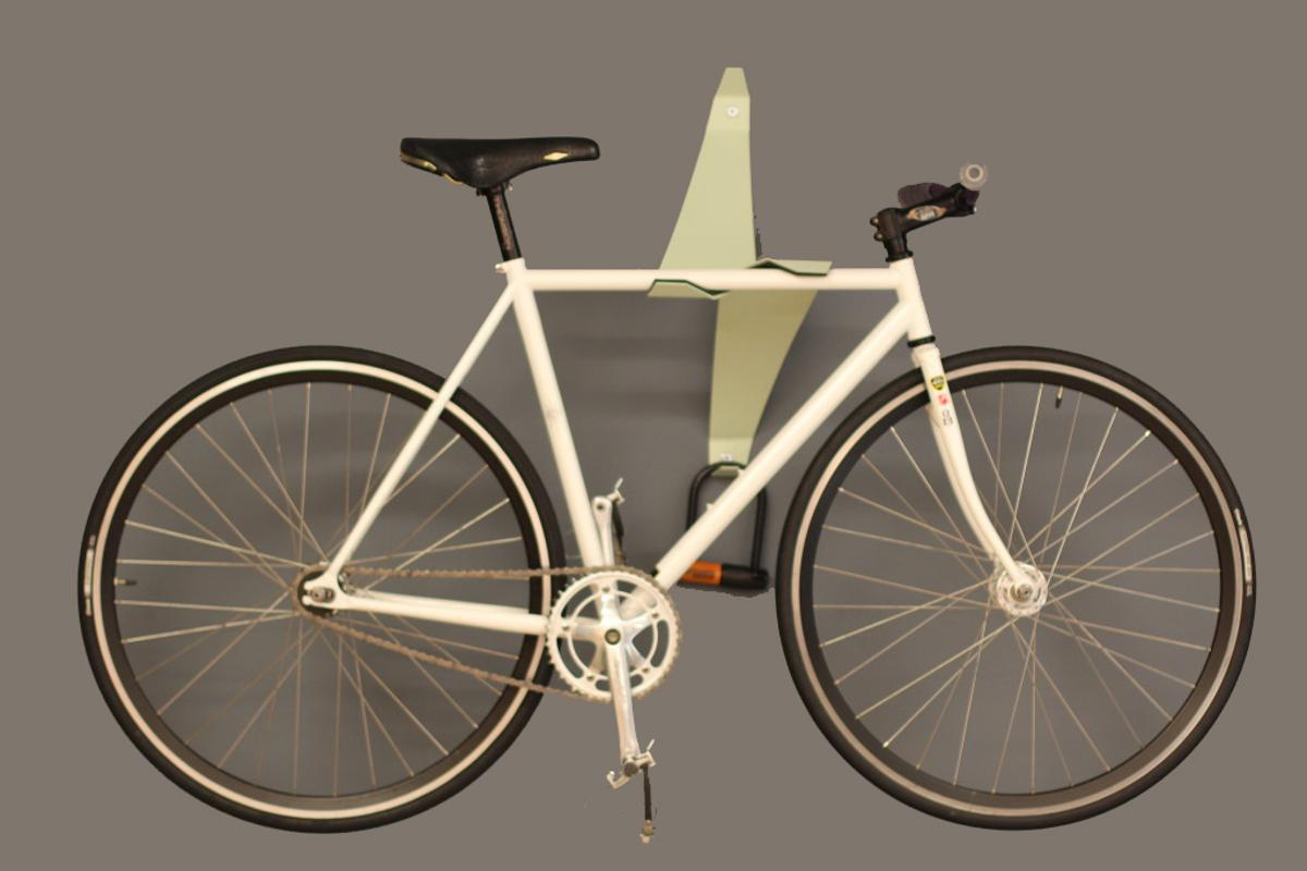 The Bike Valet is a bicycle wall storage device that uses a cantilevered design to hold bikes in place