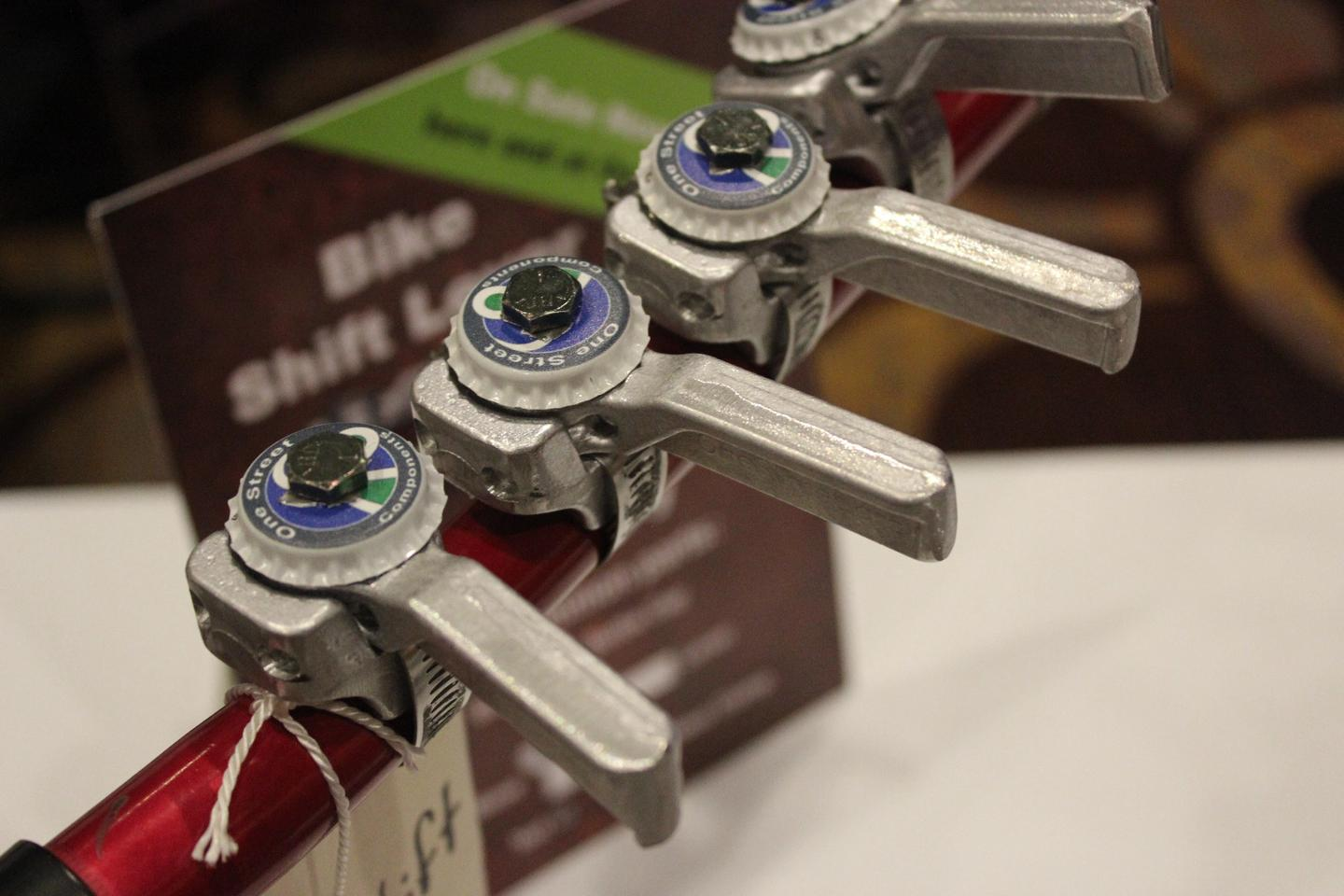 These low-cost shifters are made from bottle caps and melted scrap aluminum, using a package created by bicycle advocacy nonprofit One Street Components