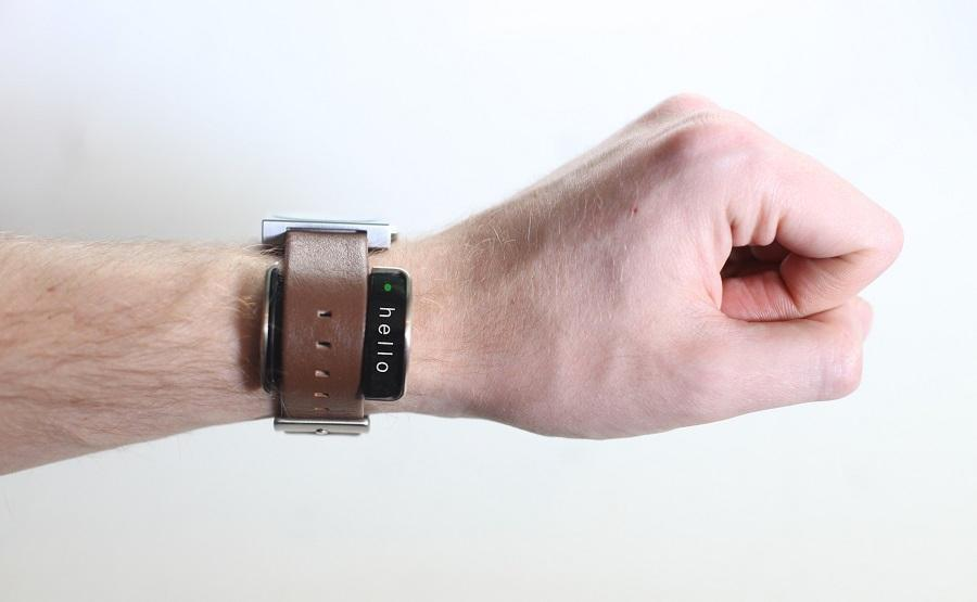 Glance slips under a user's watchstrap and provides a variety of smartwatch-type functionality