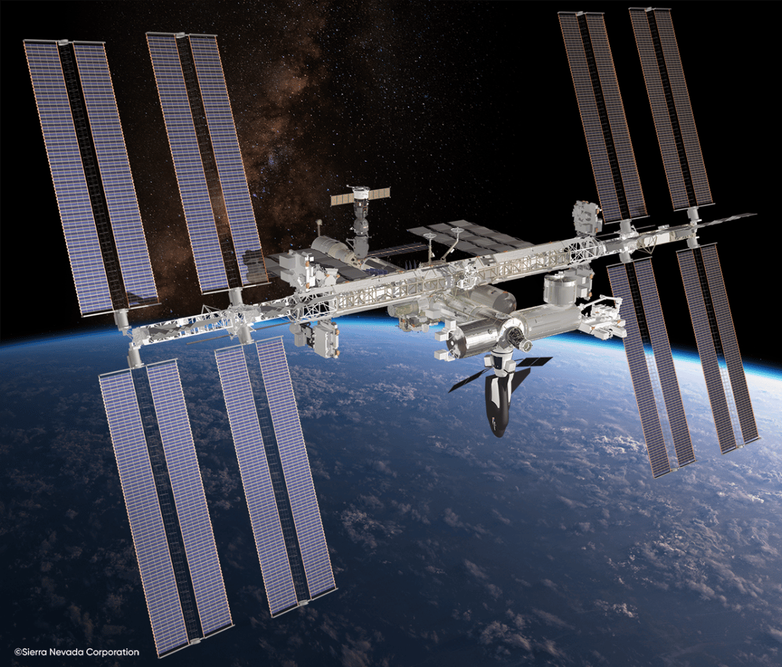 Artist's concept of the Dream Chaser cargo module docked with the ISS