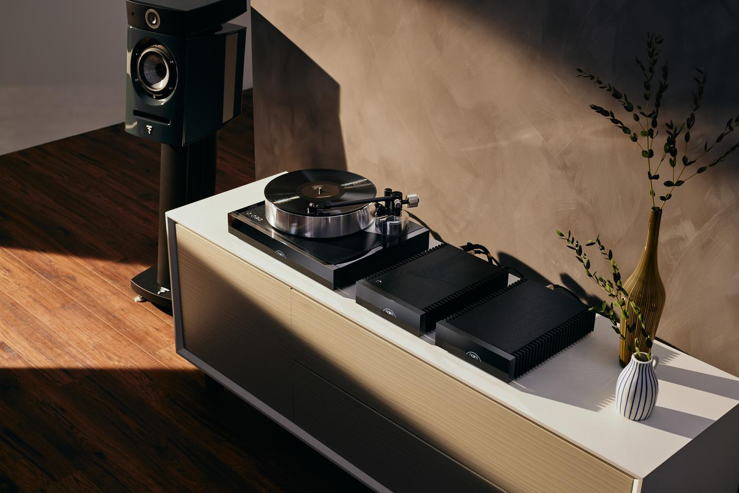 The Solstice Special Edition comprises Naim's first turntable, including a new tonearm and cartridge, a phono stage, a power supply, and a book with a vinyl record