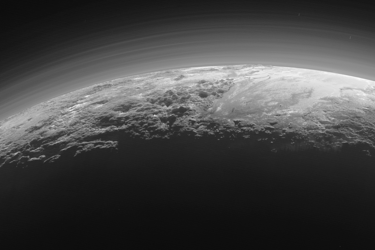 An image of Pluto's back-lit surface shot from a distance of 11,000 miles (18,000 km) by the New Horizons spacecraft