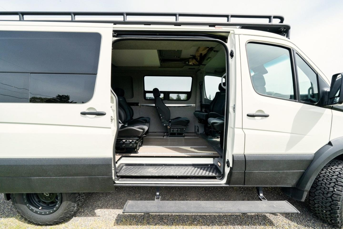 A different sytle of camper van, the Benchmark Swiss Army Sprinter features a lot of exterior upgrading with a simple sleeper interior that seats five