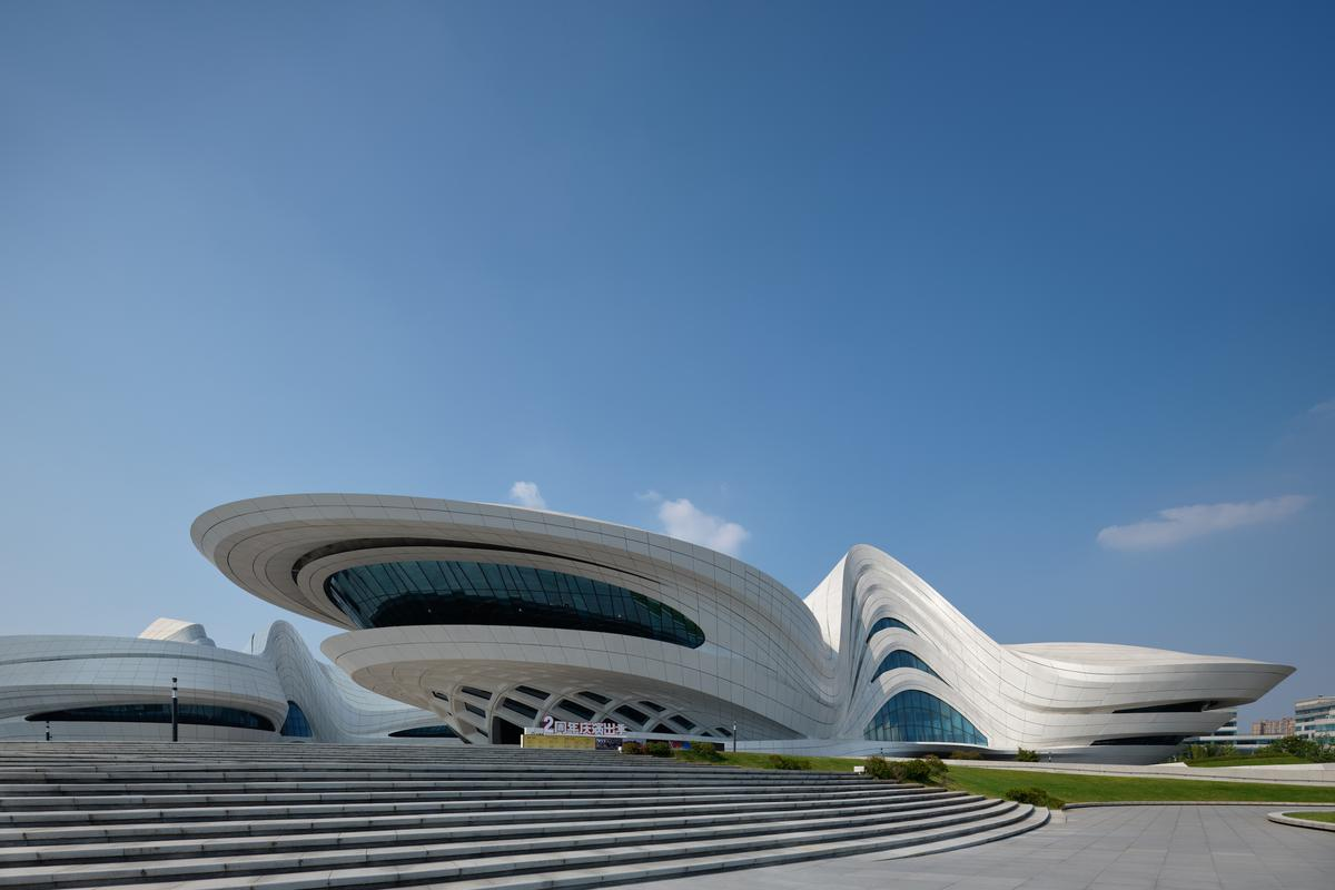 The Changsha Meixihu International Culture & Arts Centre is split into three separate buildings that are arranged around pedestrian routes that crisscross the site