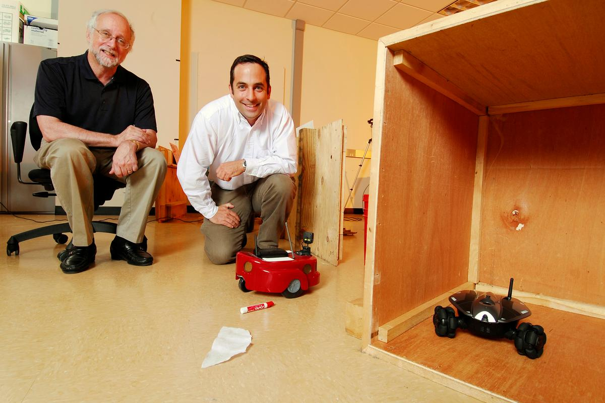Prof. Ronald Arkin (left) and research engineer Alan Wagner with their hide-and-seek-playing robots