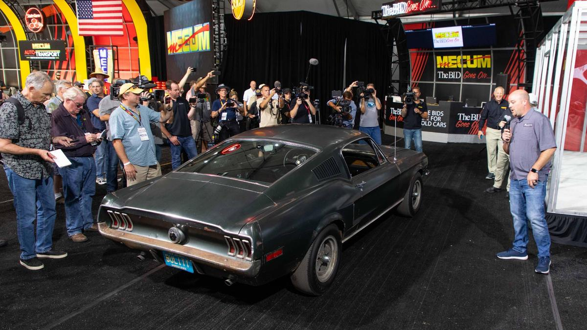 The Bullitt car's owner,Sean Kiernan (with microphone) during the announcement of the auction of the car at Mecum's Monterey 2019 auction earliertoday
