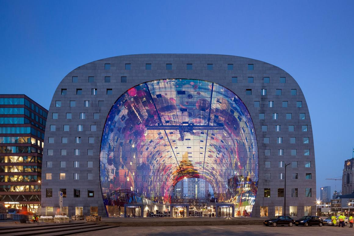Rotterdam's new market hall, Markthal, is a huge arch that houses residential apartments