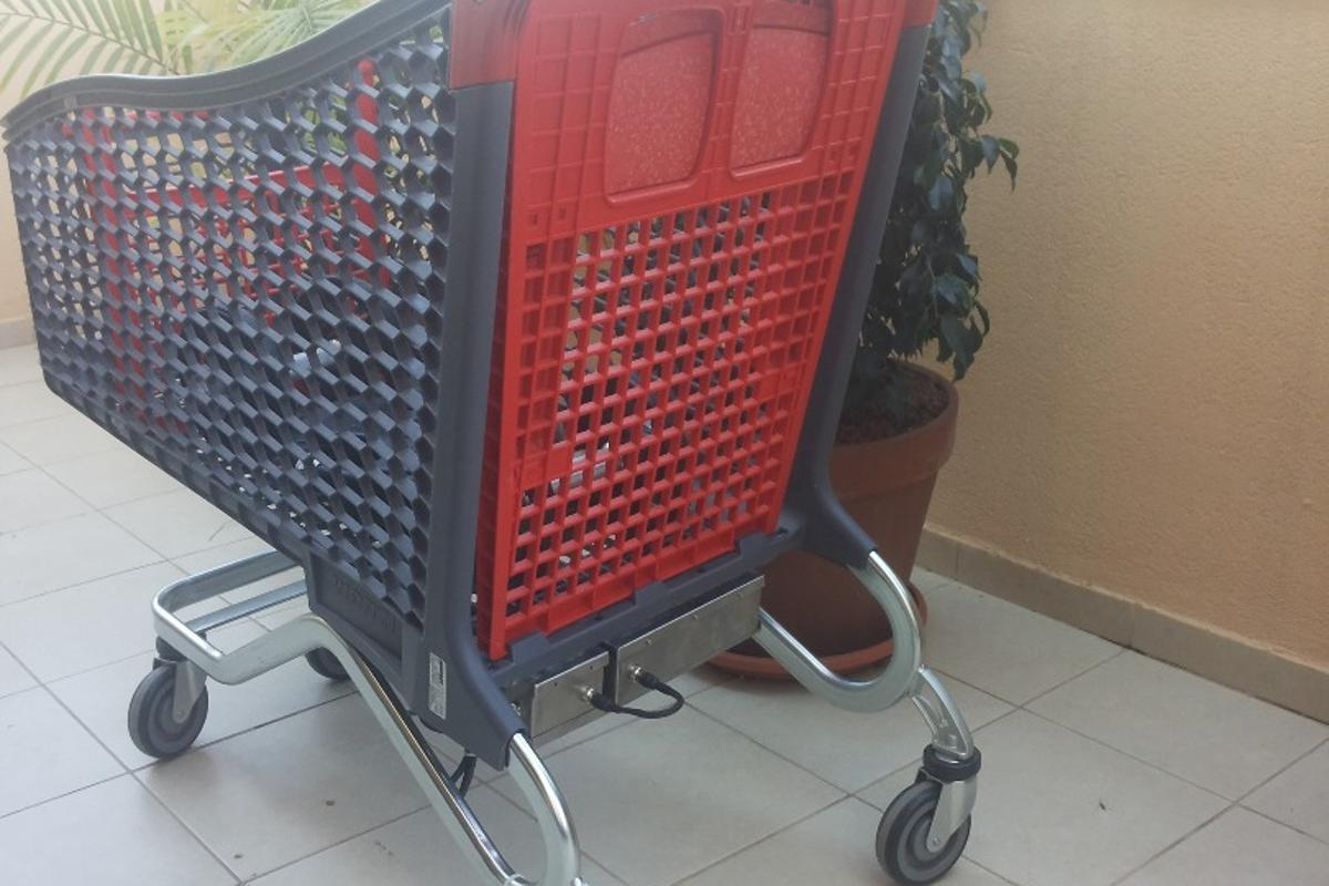 The final version of Hay's electrical super trolley, a supermarket shopping cart that has a motor on it to assist in pushing heavy loads