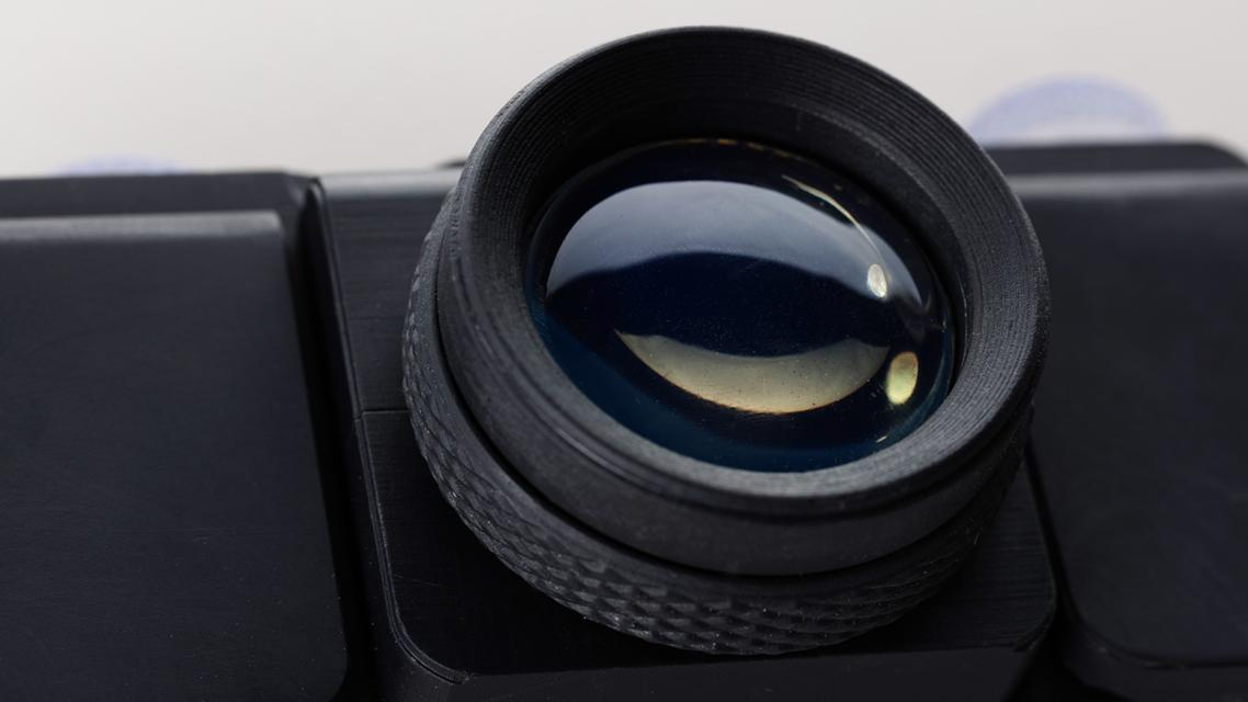 The lens is 3D-printed using a Formlabs SLA printer and clear resin, with some polishing