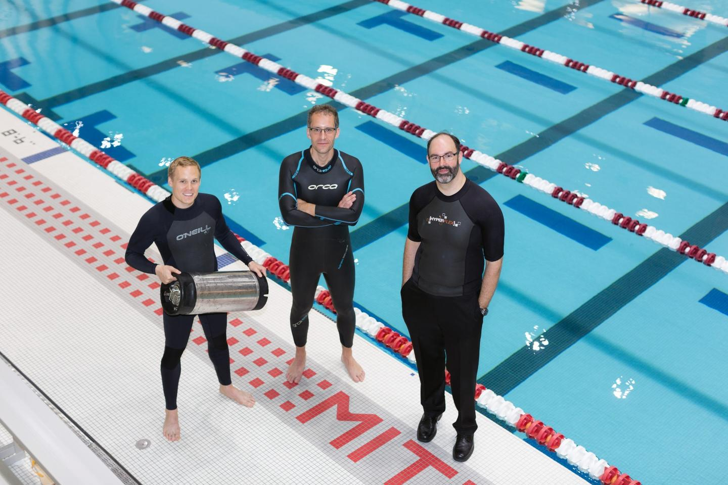 From left, graduate student Anton Cottrill, Professor Jacopo Buongiorno and Professor Michael Strano try out their neoprene wetsuits at a pool at MIT's athletic center