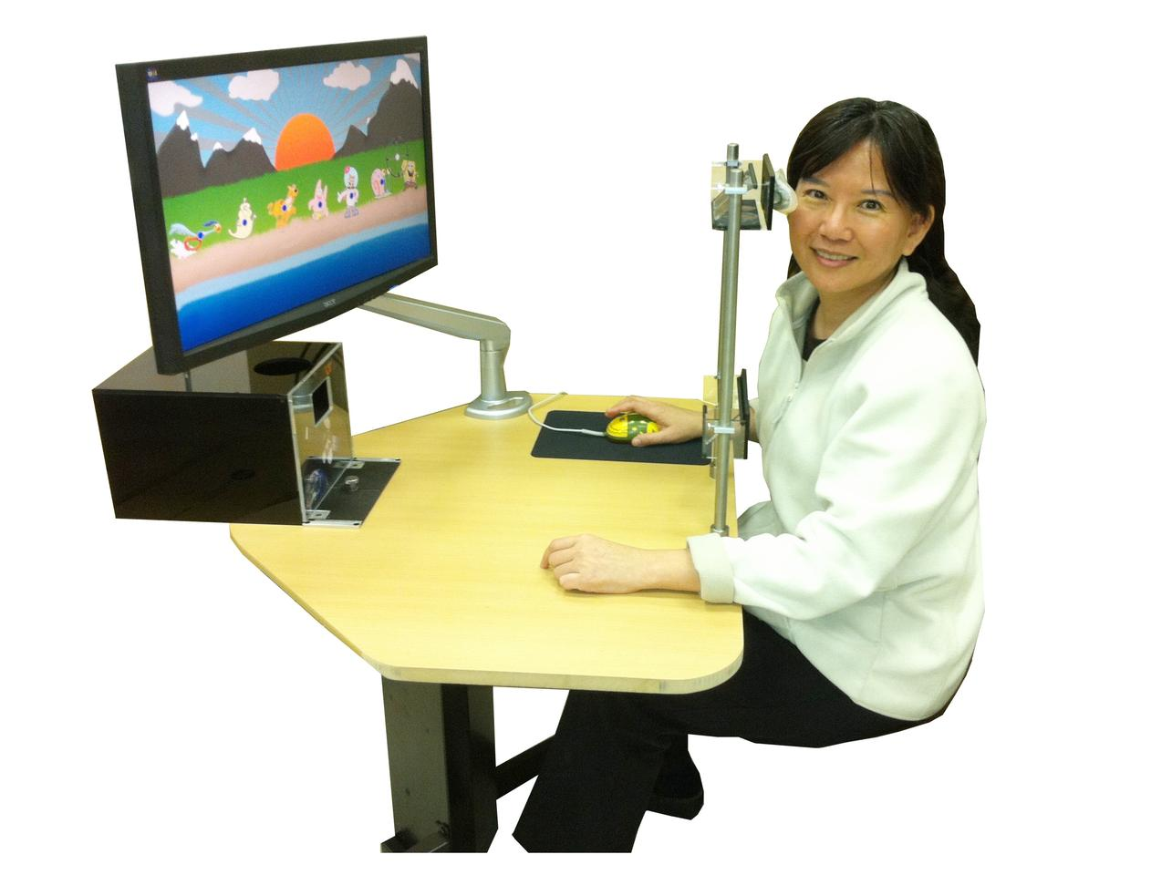 Inventor Ying-Ling Ann Chen, with the DOES device