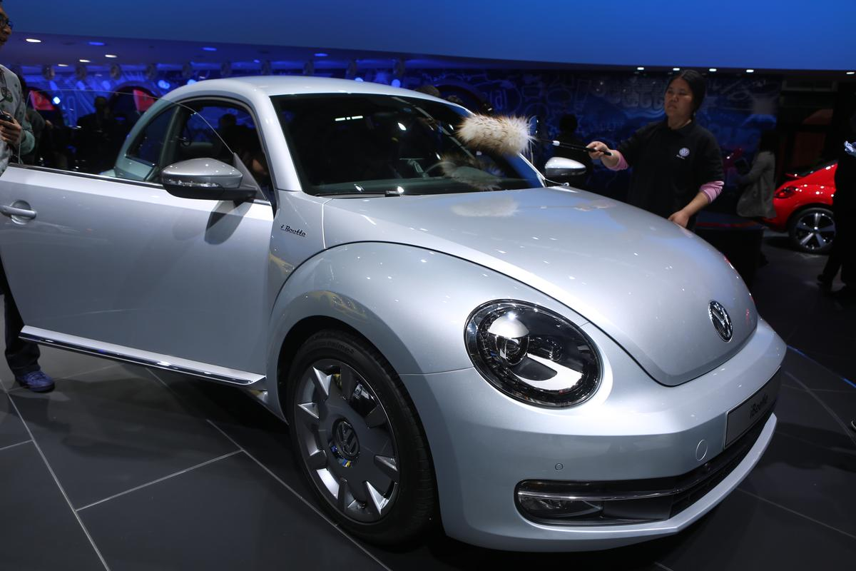 The Volkswagen iBeetle is a marriage of Volkswagen's iconic Beetle and Apple's equally iconic iPhone