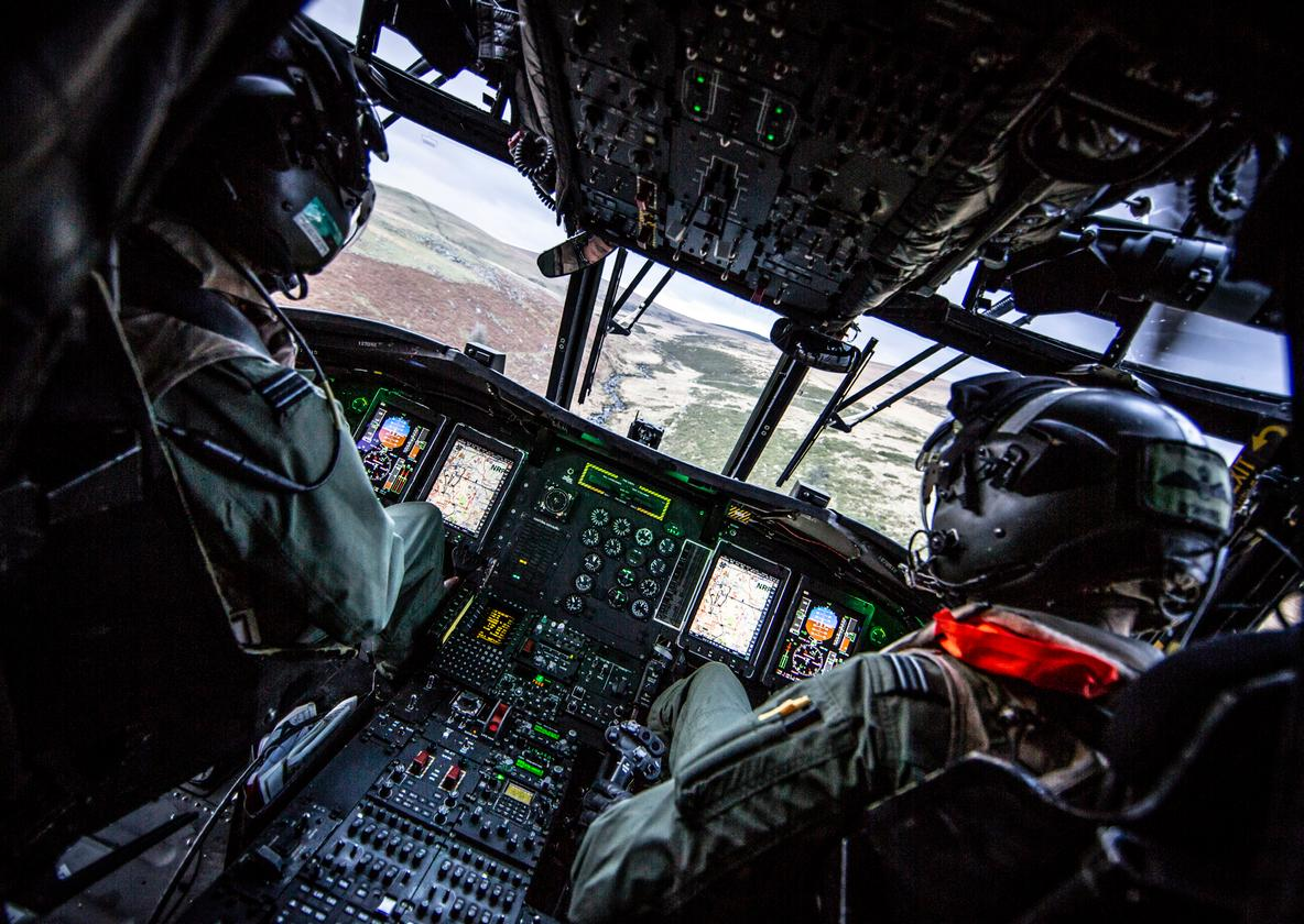 Description: Image taken from the Cockpit of Chinook Mk5 from 27 Sqn flying a Tactical evaluation sortie over Dartmoor. This Included moving Royal Marines as part of their own Training Exercise Low level Flying and undertaking a rear wheel Landing on one of Dartmoor's many tors. © MOD Crown Copyright 2018 Photographer: Cpl Rob Travis RAF Cpl Rob Travis and is currently based at RAF Odiham. He joined the RAF in June 2004 since then he has served at RAF Cottesmore, RAF Scampton, RAF Lossiemouth, The Red Arrows, RAF Cosford and RAF Valley. He has completed many detachments all over the world.