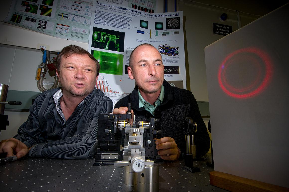 "Dr Vladlen Shvedov (left) and Dr Cyril Hnatovsky (right) with a magnified projection of the ""hollow"" laser beam (Photo: Stuart Hay, ANU)"