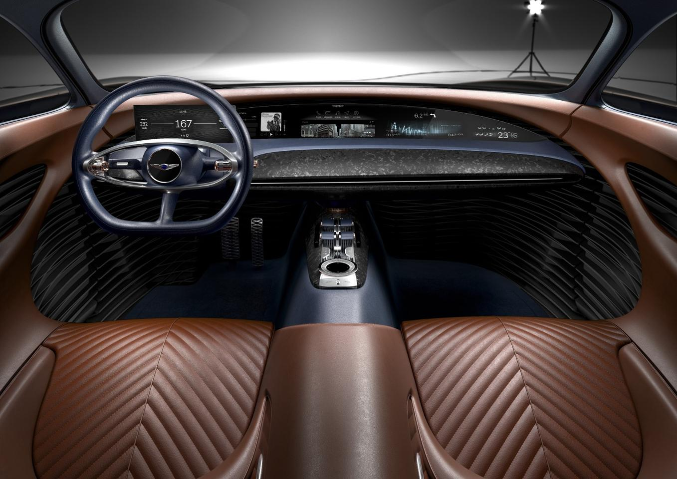 Warm Cognac leather in the Genesis Essentia concept wraps the front occupants while a full-length digital dash keeps them engaged