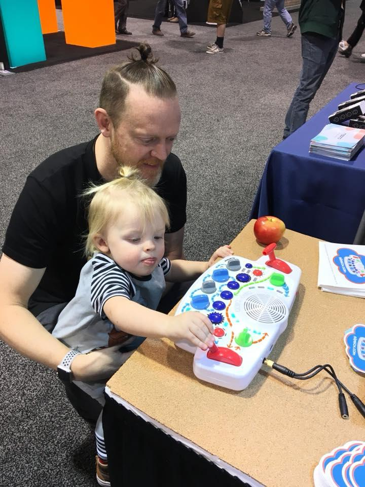 A toddler gets to grips with the Blipblox synthesizer at the NAMM show in California