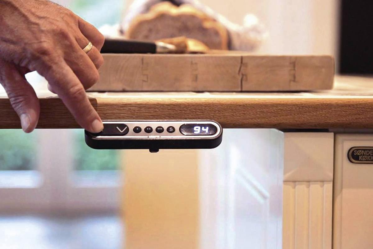 Users can adjust the height of a kitchen unit by simply pressing up or down Baselift system buttons