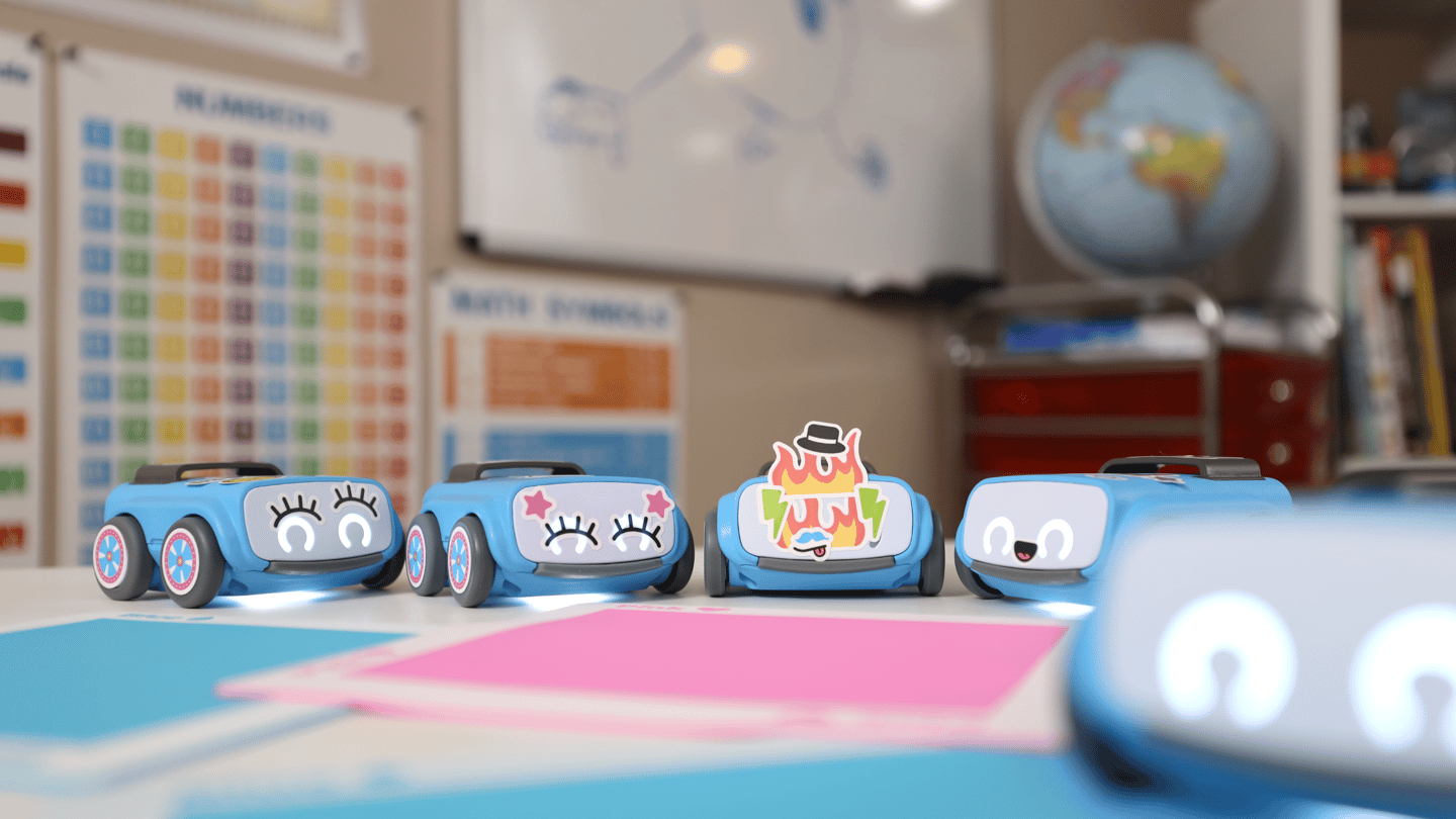 The learning kits come with an indi robot car, some tiles that serve as color-coded instructions for the bot, some challenges, and some stickers to customize the little bot