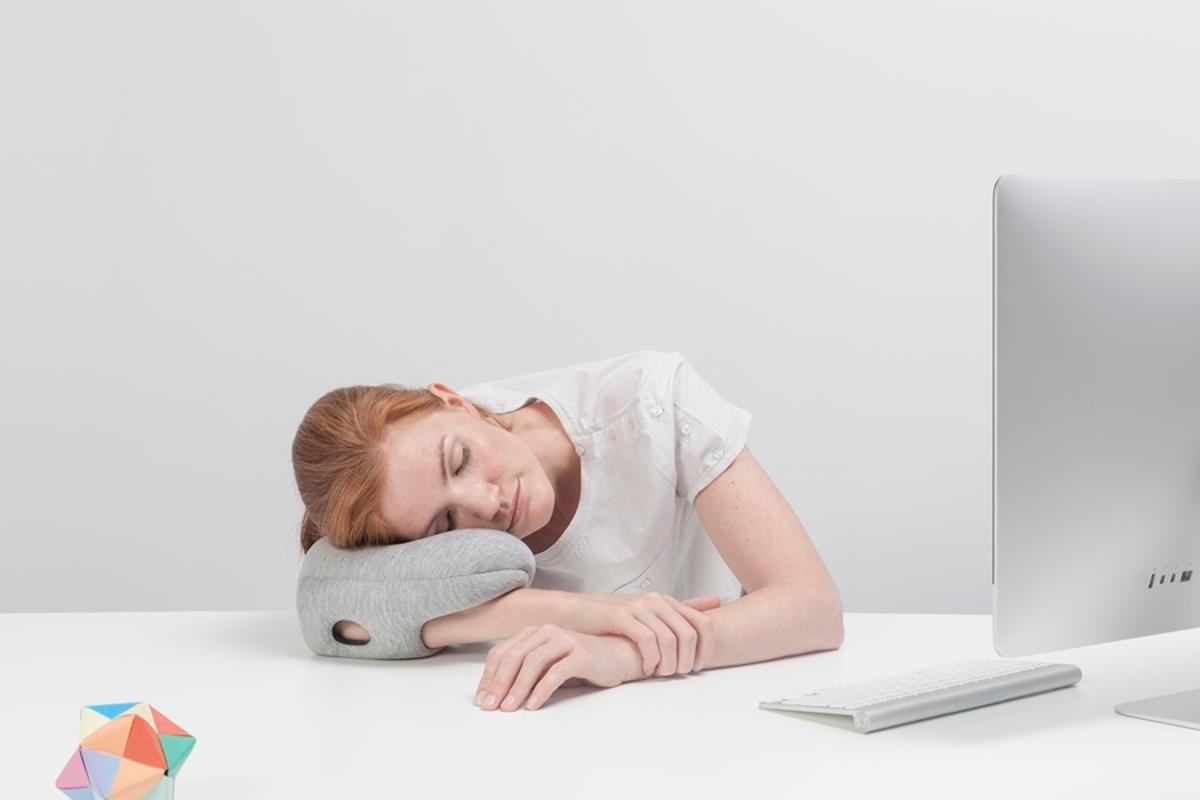 The Ostrich Pillow Mini is designed to let people nap wherever they are