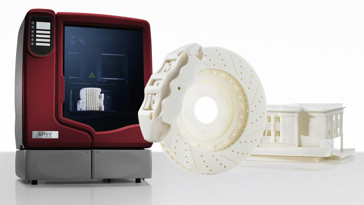 Dimension's uPrint 3D printer and a couple of examples of the kinds of shapes it can print.