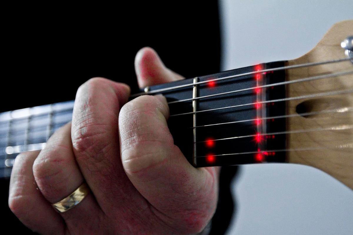 The Fretlight learning system uses LED lighting to show students finger placement on a guitar neck, with lights triggered in response to video-based lessons and/or software on a computer