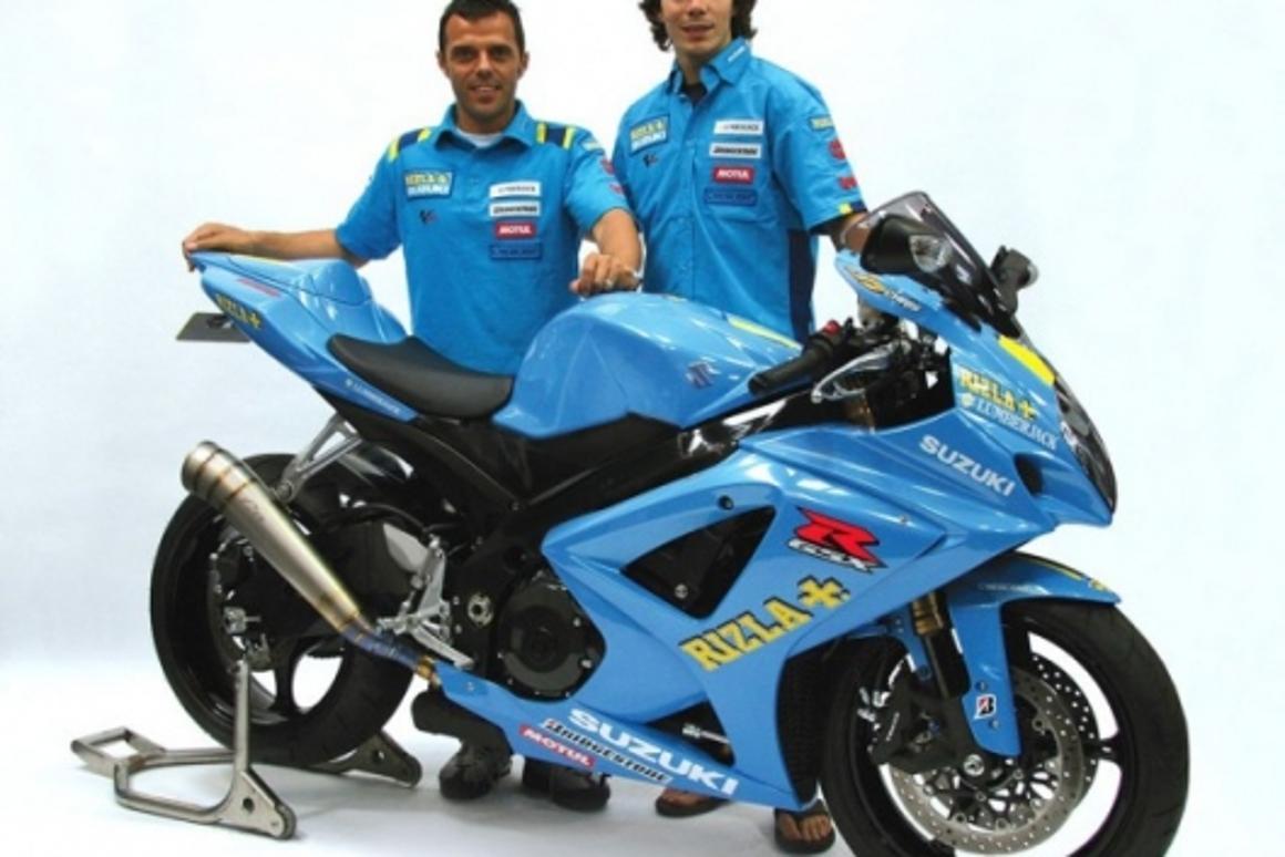 Works riders Loris Capirosi and Chris Vermeulen and the replica