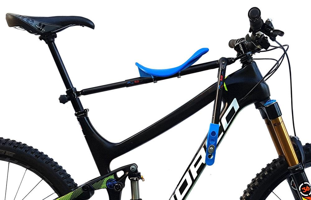The Mac Ride consists of a seat and stirrups, mounted on a telescoping pole that should attach to most mountain bikes