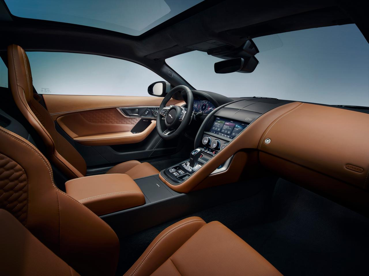 "Jaguar calls the F-Type's driver-focused interior a ""1 + 1"" layout"