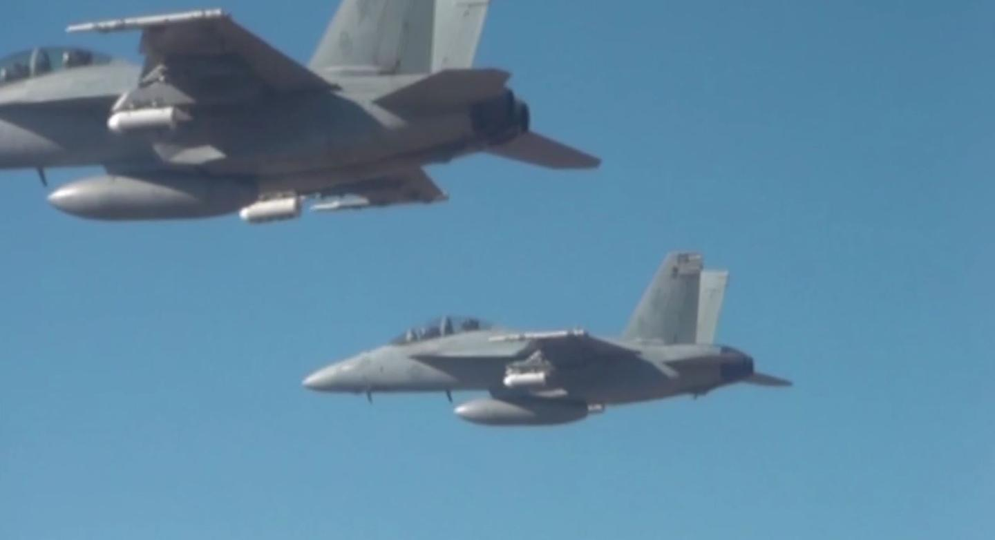 The 103 drones were dropped from flare dispensers mounted on three F/A-18 Super Hornets