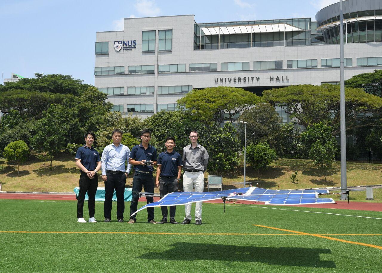 Aaron Danner (right) and his student team, with the solar-powered drone