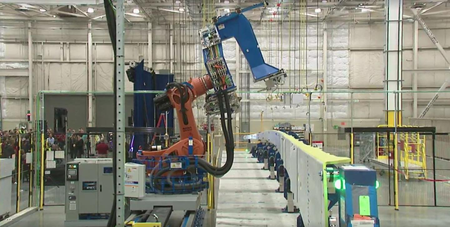 A robot began drilling the composite spar for the 777X