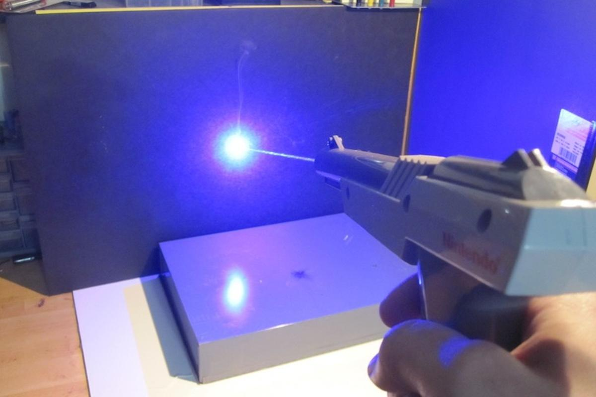 A hacker has retrofitted a classic NES Zapper with a powerful laser, resulting in a gun that is anything but a toy