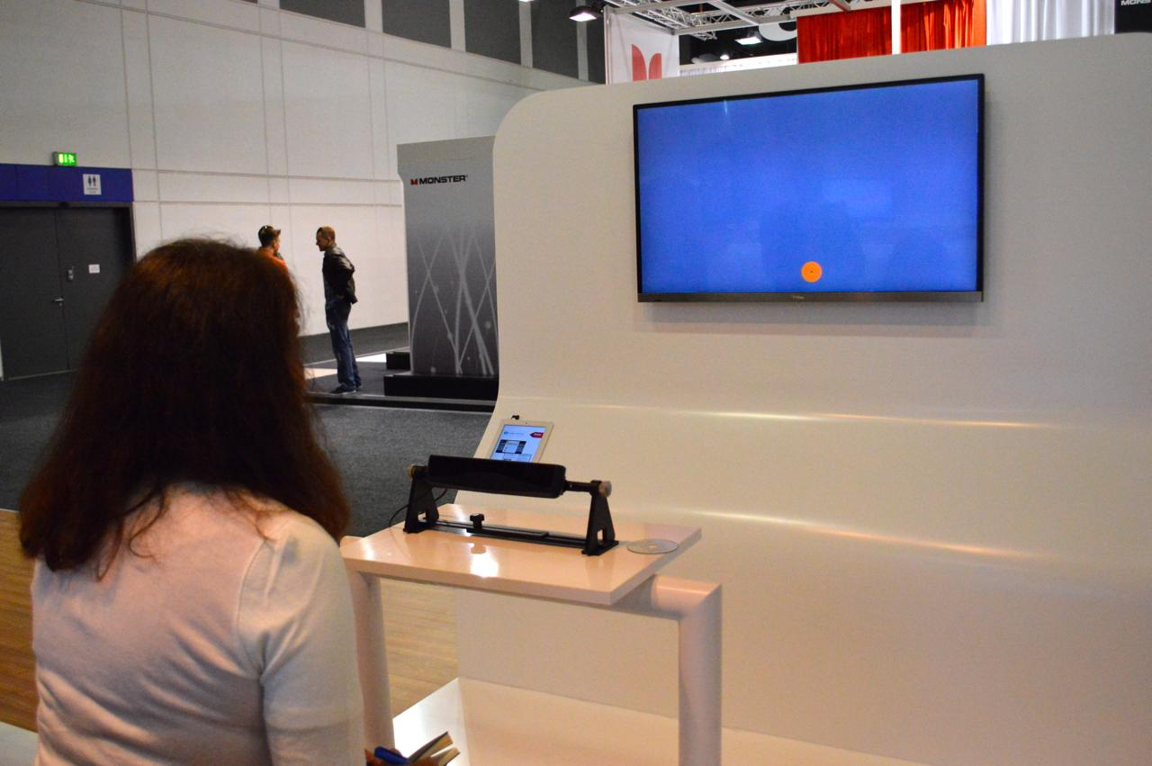 The calibration process requires each user to track an orange dot as it moves around the screen