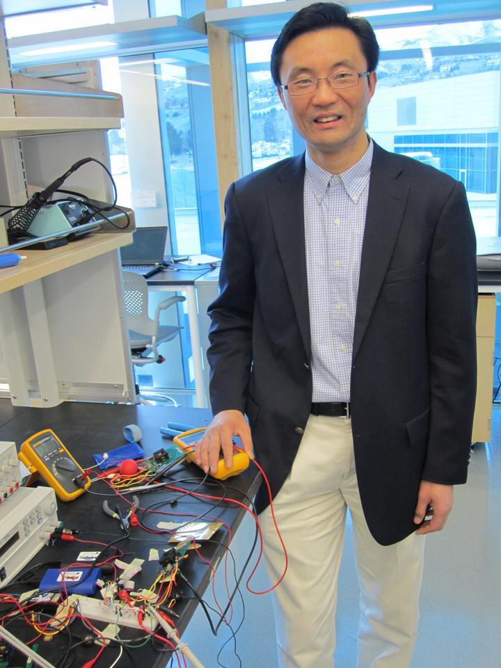 University of Utah electrical engineer Darrin Young developed the tiny prototype microphone (Photo: Lee J. Siegel, University of Utah)