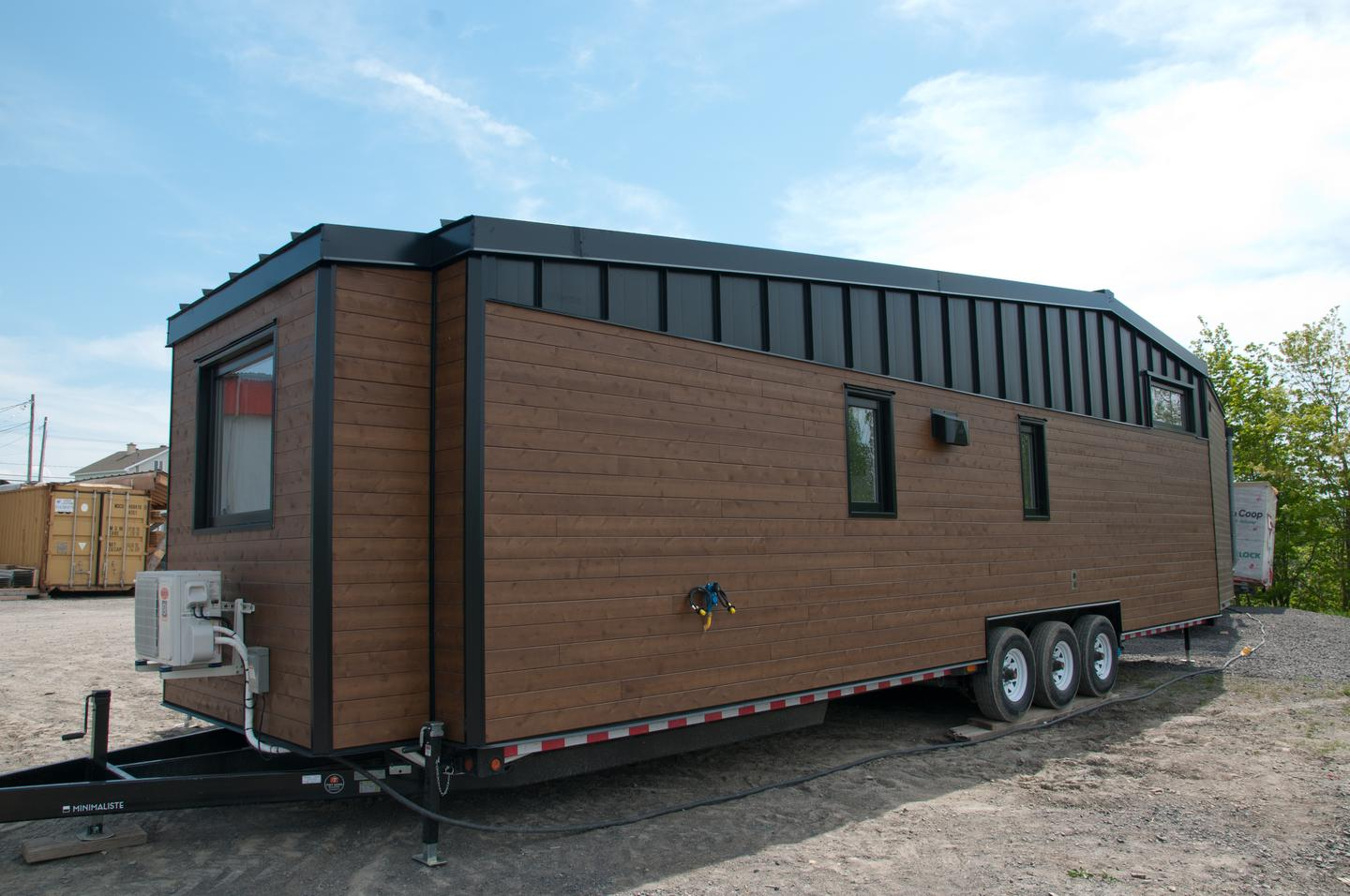 The Noyer XL V2 is based on a triple-axle trailer and is finished in horizontal cedar and vertical steel
