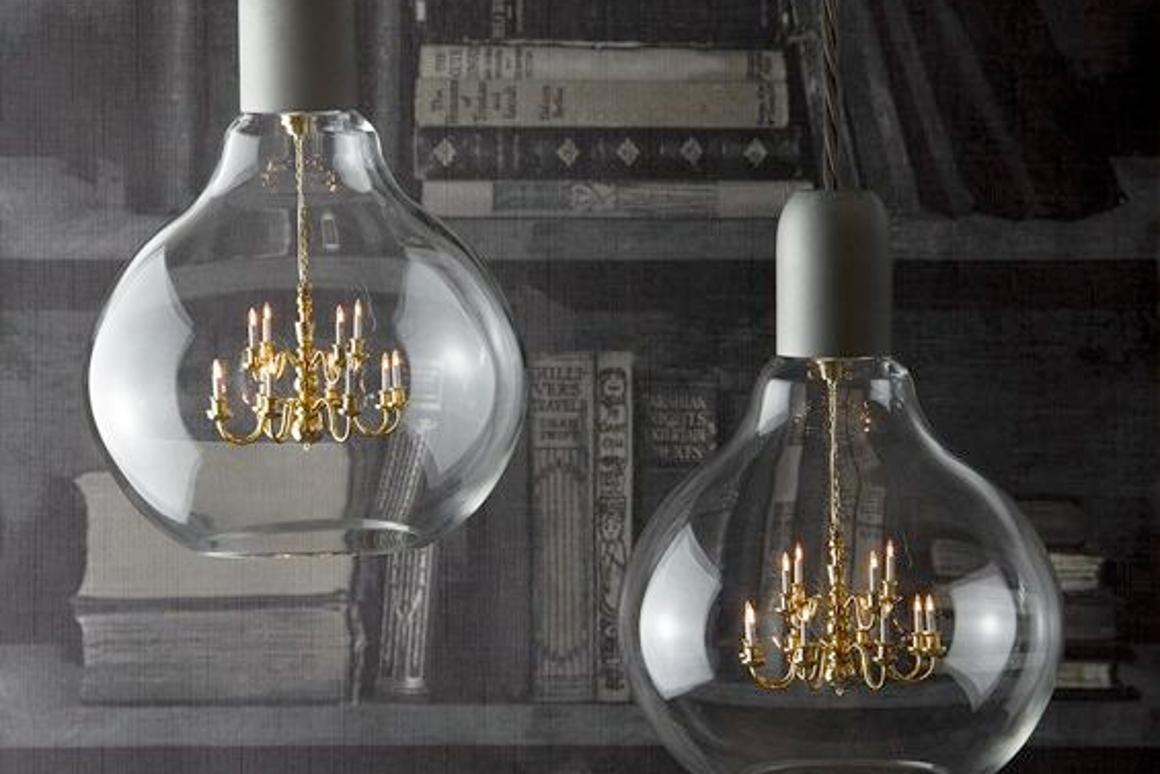 The King Edison Pendant Lamp consists of a tiny working chandelier encased in a light bulb-like glass globe