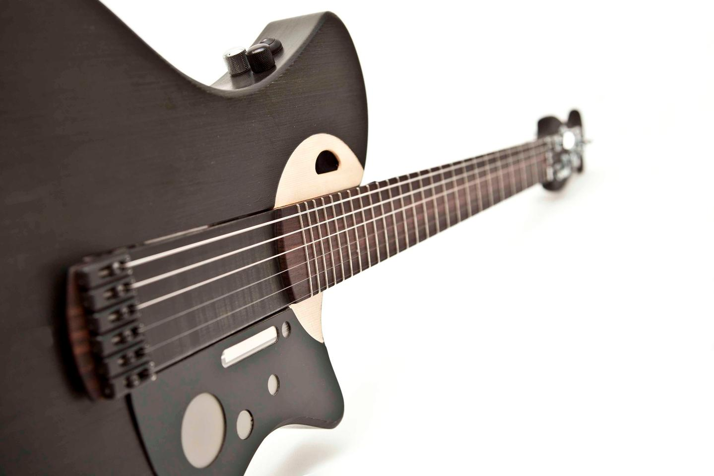 All sound is output from the wooden body of the guitar thanks to Mind's patented technologies