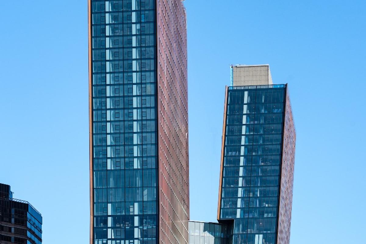 The American Copper Buildings are connected by a sky bridge which includes amenities like a lap pool and hot tub