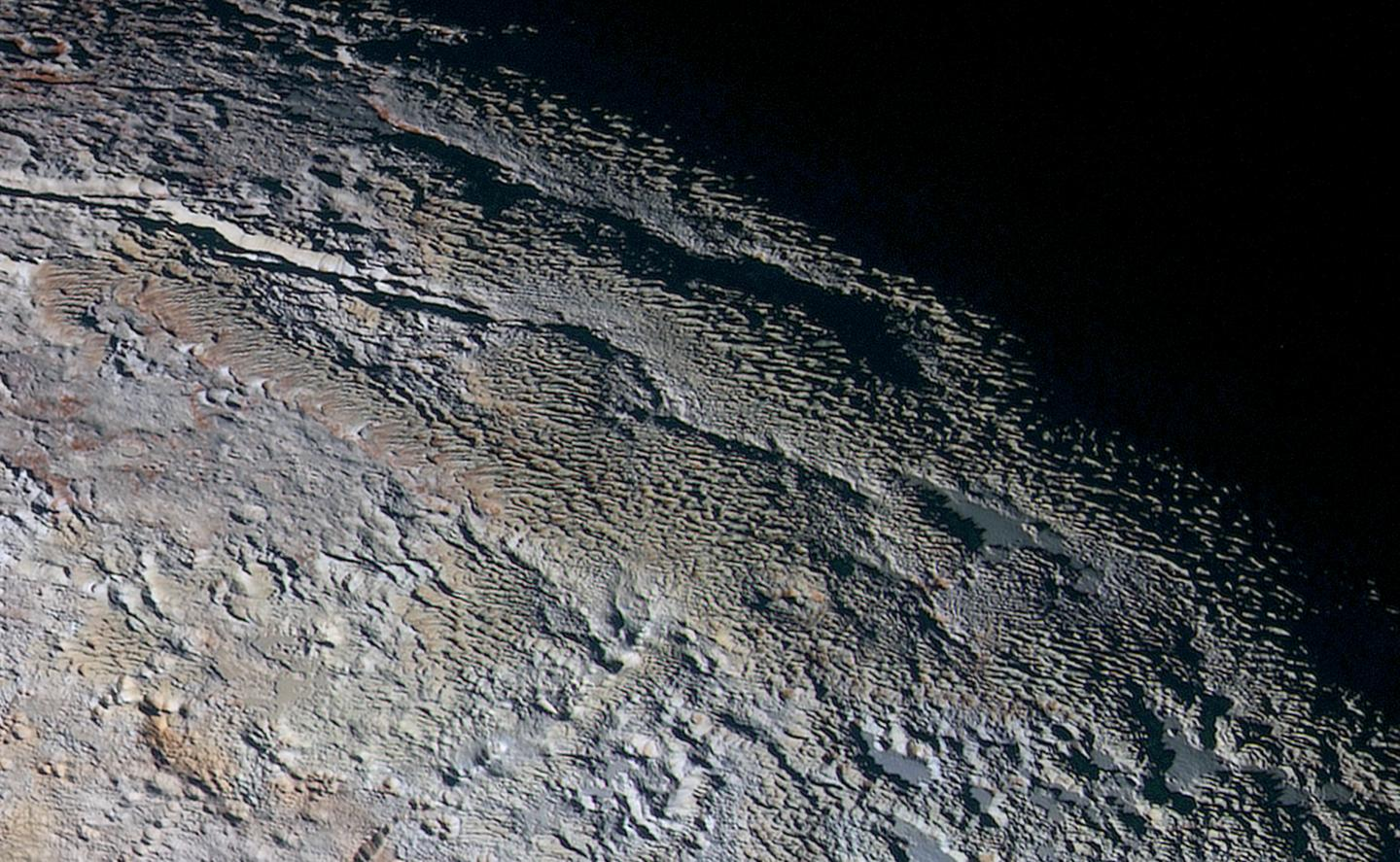 High resolution image of the Tartarus Dorsa mountain range spanning 330 miles (530 km) across