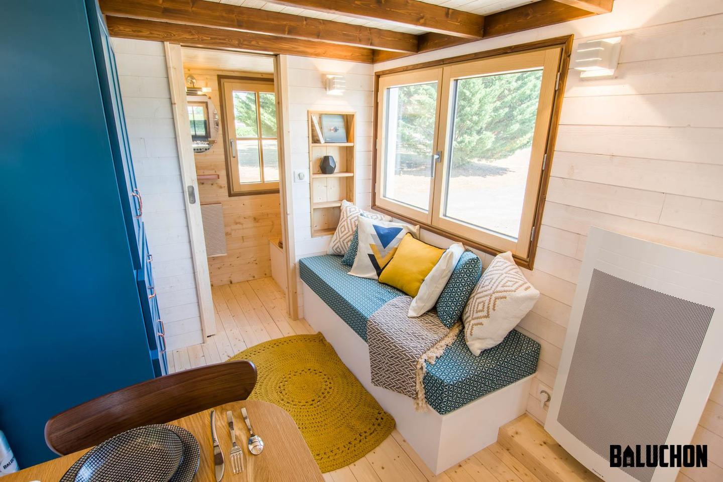 The Solaris tiny house has a small living area that includes a sofa