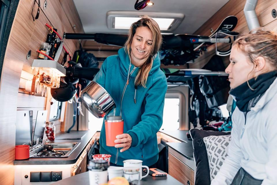 The passenger-side kitchen is the start of a long countertop that extends back to the rear door, offeringwork space and a support for the inflatable SUP mattresses