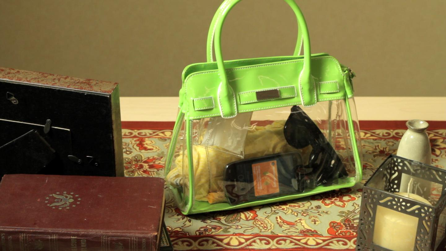 A new Nokia Lumia phone is wirelessly charged while it's inside a handbag