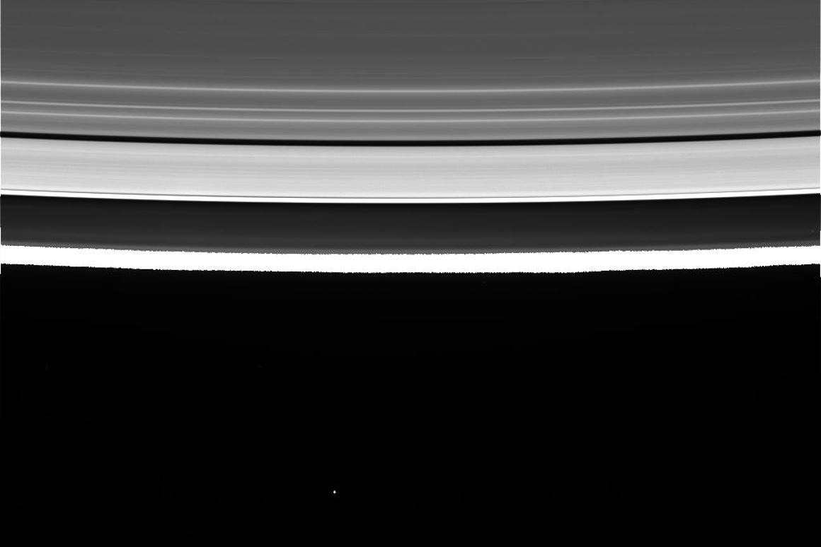 An unprocessed image of Saturn's rings, with Saturn's dark outline, as captured by Cassini during its maiden Grand Finale dive