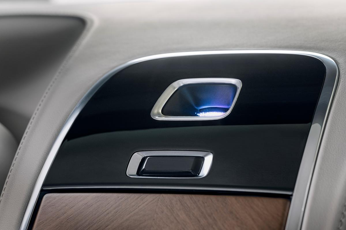 Abuilt-in projector casts visual displays on the headliner